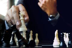 Businessman thinking how to  win. Businessman thinking how to play chess concept business strategy for win Royalty Free Stock Photography