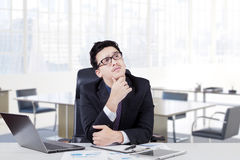 Businessman thinking idea with hand on his chin Stock Image
