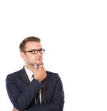 Businessman thinking, look away, finger on his chin Royalty Free Stock Images