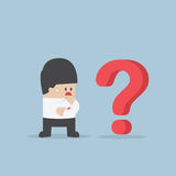 Businessman thinking while looking at question mark. VECTOR, EPS10 Stock Photo