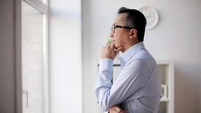 Businessman thinking at office stock footage