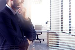 Businessman thinking in office Stock Image