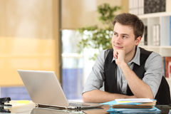 Businessman thinking and planning at office Stock Photos