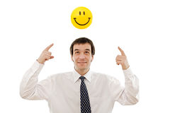 Businessman thinking positive. Businessman with smiley sign - concept of positive thinking Stock Photos