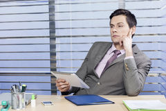 Businessman thinking. About the problem Stock Photography