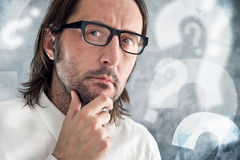 Businessman thinking and questioning. Portrait of thoughtful business person Royalty Free Stock Photo