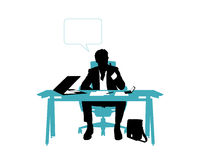 Businessman thinking seated in his office desk Royalty Free Stock Image