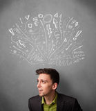 Businessman thinking with sketched arrows above his head Royalty Free Stock Photo