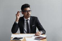 Businessman thinking of something. Businessman thinking of something on grey background Stock Photography