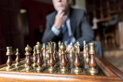 Businessman thinking about strategic move. Strategy concept Stock Photos