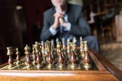 Businessman thinking about strategic move Stock Photo