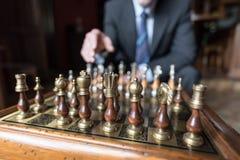 Businessman thinking about strategic move Stock Image