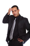 Businessman thinking touching forehead Stock Image
