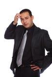 Businessman thinking touching forehead Stock Image