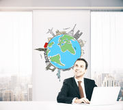 Businessman thinking about traveling. Smiling businessman in office with globe and sights sketch on wall thinking about business trip. Traveling concept. 3D Stock Photos