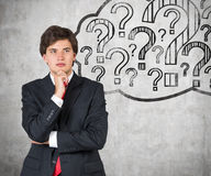Businessman thinking. Young businessman thinking and drawing question mark Stock Photography