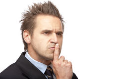 Businessman thinks contemplative on problem stock photography