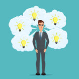 Businessman thinks a lot of ideas in the form of lamps. Business Royalty Free Stock Image