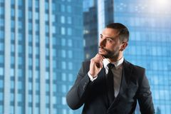 Businessman thinks new strategies to grow up the company. Businessman thinks new business strategies to grow up the company royalty free stock photo