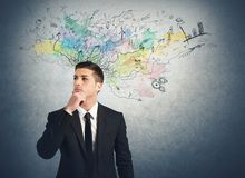 Businessman thinks for new ideas Royalty Free Stock Images