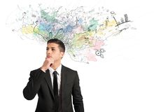 Businessman thinks for new ideas Stock Photo