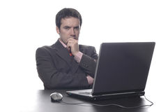 Businessman thoughtful in a su Royalty Free Stock Photos