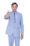 businessman thoughtful with thumbs up Stock Photography