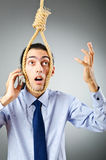 Businessman with thoughts of suicide Royalty Free Stock Image