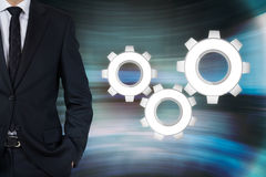 Businessman and three cogwheel Stock Photography
