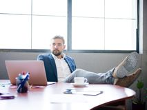The businessman threw his legs on the desk to relax royalty free stock image