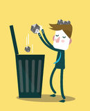 Businessman throw paper waste from his head into trash bin. Royalty Free Stock Photography