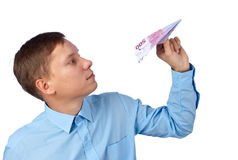 Businessman throwing a airplane Royalty Free Stock Images