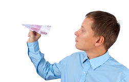 Businessman throwing a airplane Stock Images