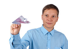 Businessman throwing a airplane Royalty Free Stock Image