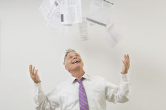 Businessman Throwing Bills In The Air Royalty Free Stock Images