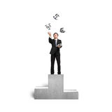Businessman throwing and catching 3D sliver money symbols on pod Stock Images