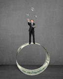 Businessman throwing and catching money symbols on money circle Royalty Free Stock Images