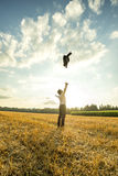 Businessman Throwing Coat in the Air at the Field Royalty Free Stock Photography
