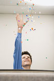 Businessman throwing confetti Royalty Free Stock Photos