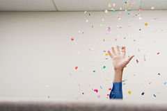 Businessman throwing confetti in the air Royalty Free Stock Photos