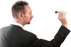 Businessman Throwing a Dart Stock Images
