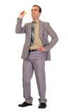 Businessman Throwing Darts. Full body view of a businessman throwing a dart, isolated against a white background stock photography