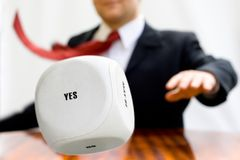 Businessman throwing the dice to make a decision. Yes, No or Maybe. Concept of success royalty free stock photos