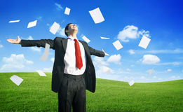 Businessman Throwing Documents. On a hill royalty free stock photos