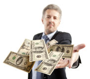 Businessman throwing dollar Royalty Free Stock Photography