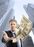 Businessman throwing dollar Stock Image