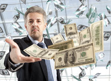 Businessman throwing dollar Stock Photography