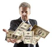Businessman throwing dollar Royalty Free Stock Photos