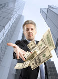 Businessman throwing dollar Royalty Free Stock Photo