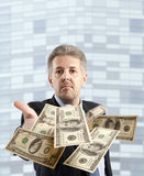 Businessman throwing dollar Royalty Free Stock Images